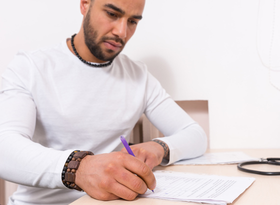 man completing medical form