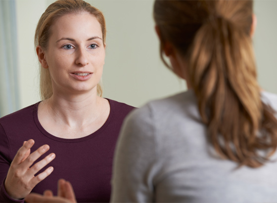 a woman talking to a psychotherapist