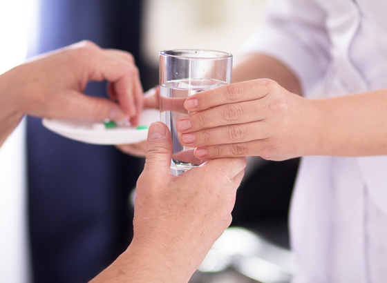 nurse giving detox medication
