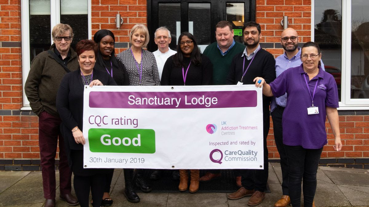 the sanctuary lodge team holding cqc result banner