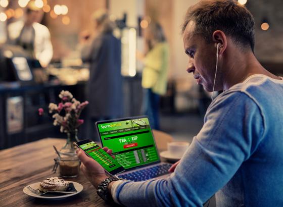 a man gambling on a computer